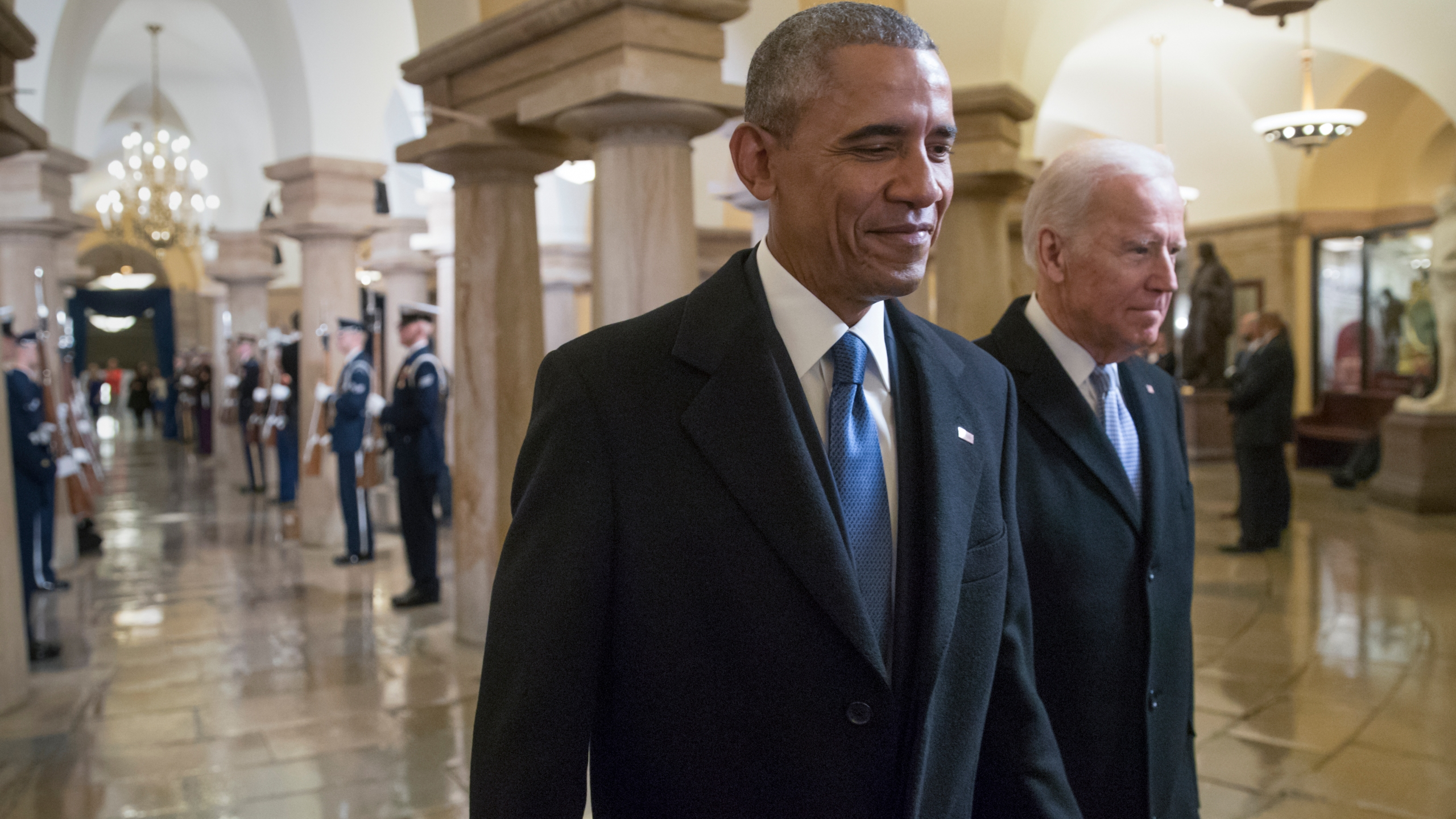 President Barack Obama and Vice President Joe Biden walk through the Crypt of the Capitol for Donald Trump's inauguration ceremony, in Washington, January 20, 2017. (J. Scott Applewhite - Pool/Getty Images)