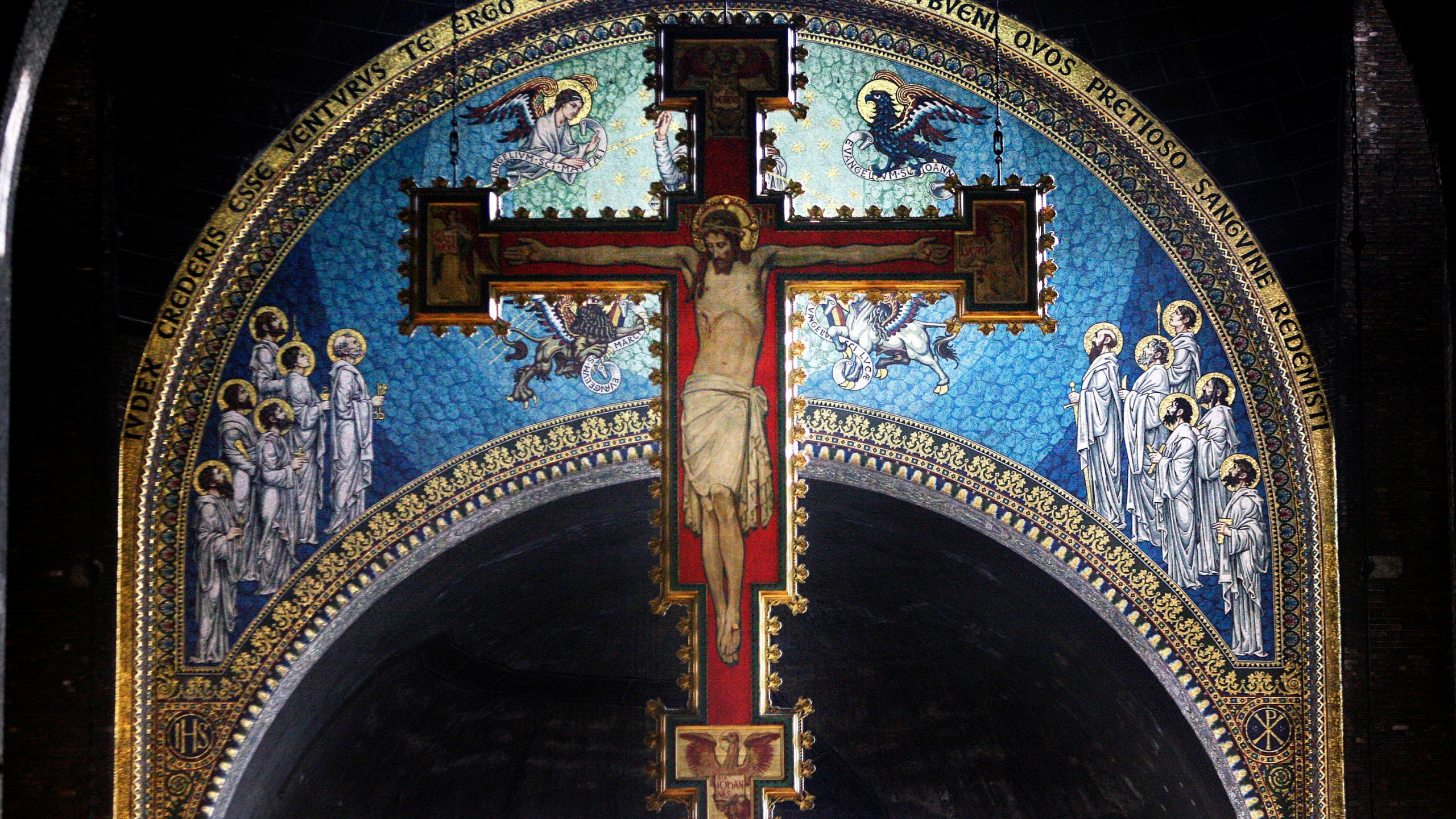 A cross with a painting of Jesus Christ hangs over the alter at Westminster Cathedral on February 21, 2007, in London. (Peter Macdiarmid/Getty Images)