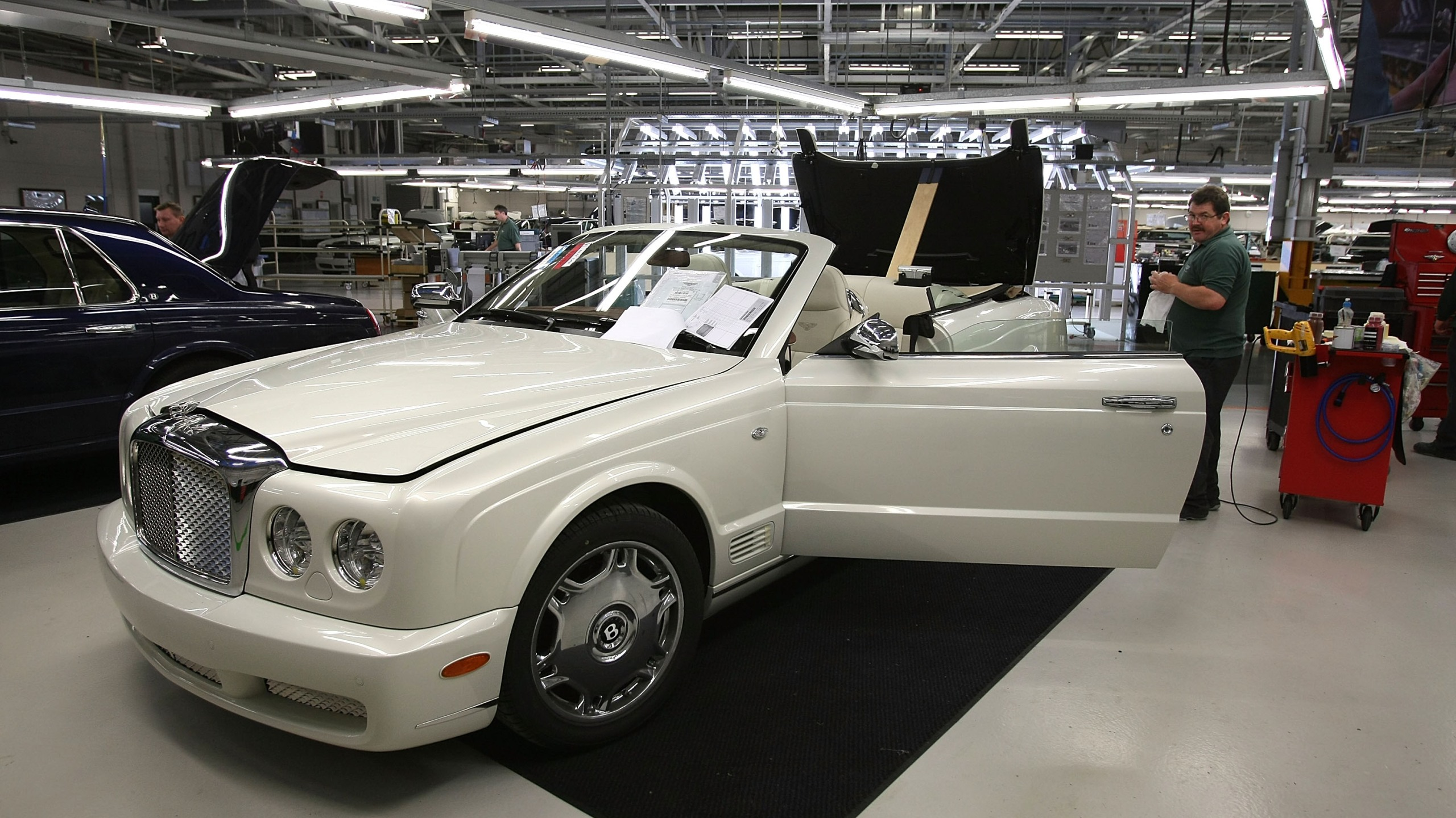 A Bentley undergoes final preparation and inspection in the Mulliner workshop at the Bentley Motors Factory on 19 November, 2007, in Crewe, England. (Christopher Furlong/Getty Images)