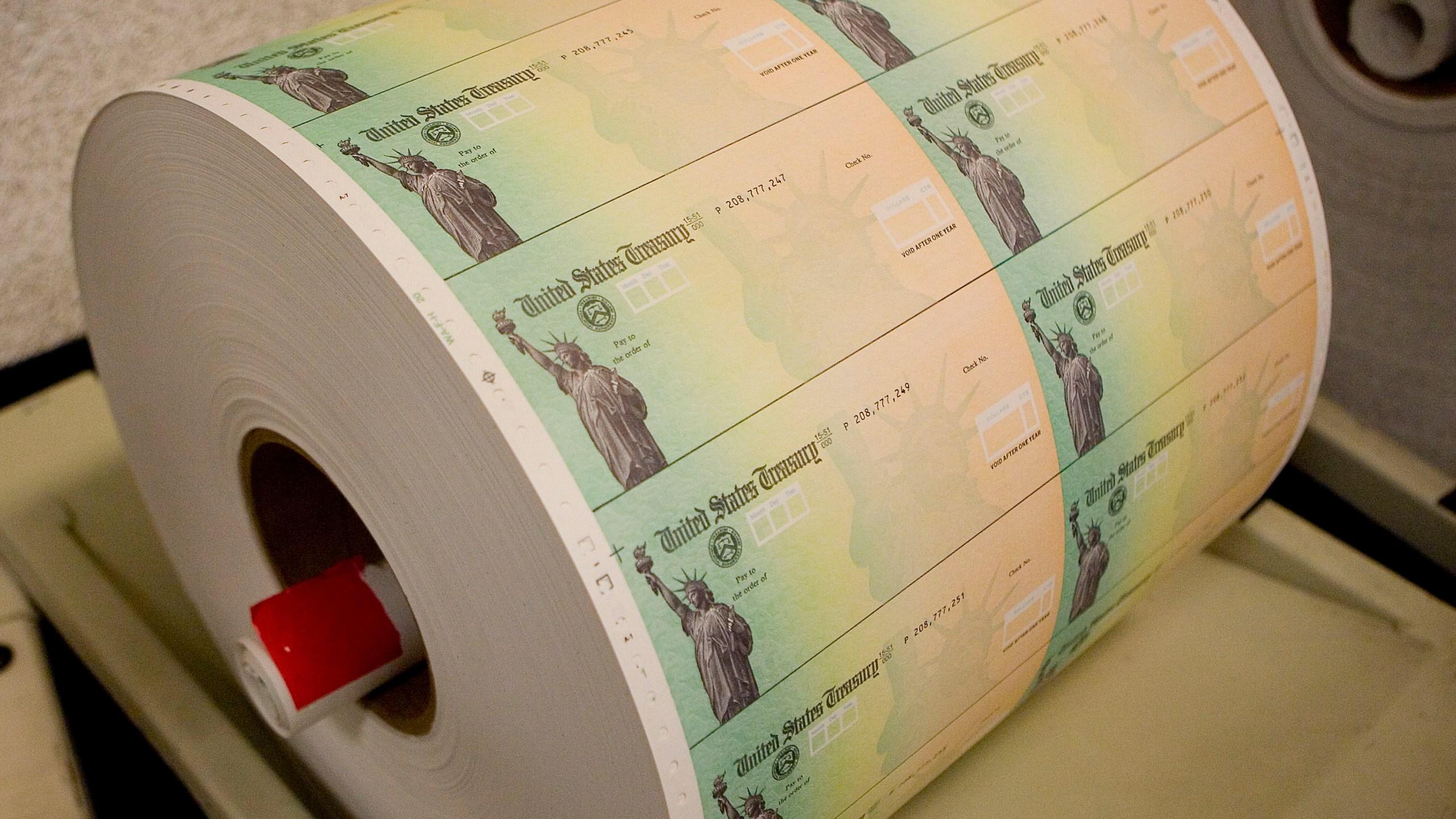 Economic stimulus checks are prepared for printing at the Philadelphia Financial Center May 8, 2008 in Philadelphia, Pennsylvania. (Jeff Fusco/Getty Images)