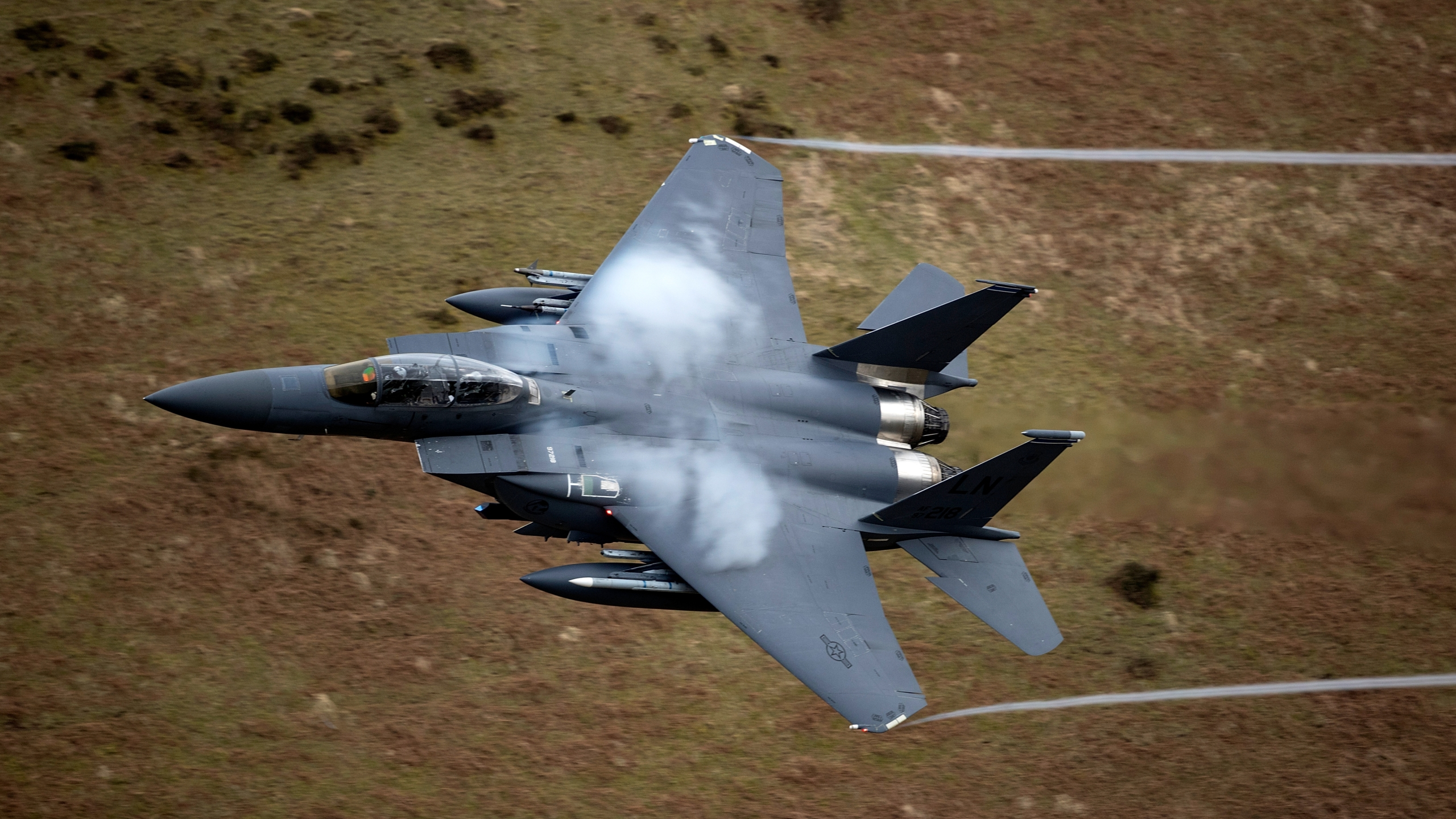 A United States Air Force F-15 fighter jet based at RAF Lakenheath speeds through the Dinas Pass, known in the aviation world as the Mach Loop on February 16, 2018 in Dolgellau, Wales. (Christopher Furlong/Getty Images)
