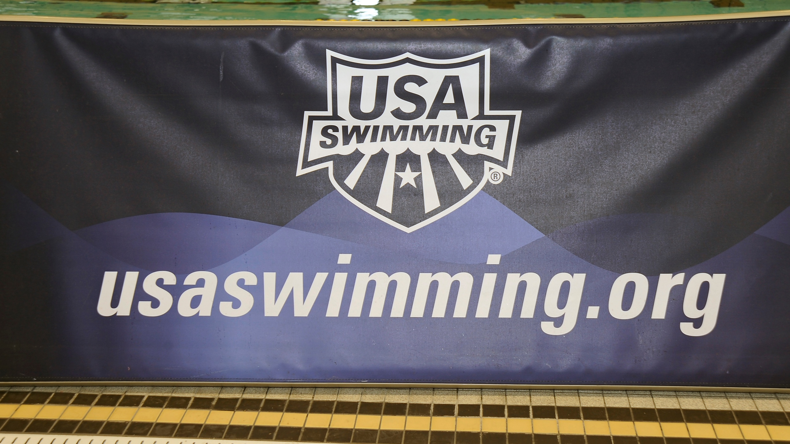 A banner for the USA Swimming foundation is displayed at the Missouri Grand Prix on February 15, 2010 at the Mizzou Aquatic Center in Columbia, Missouri. (G. Newman Lowrance/Getty Images)