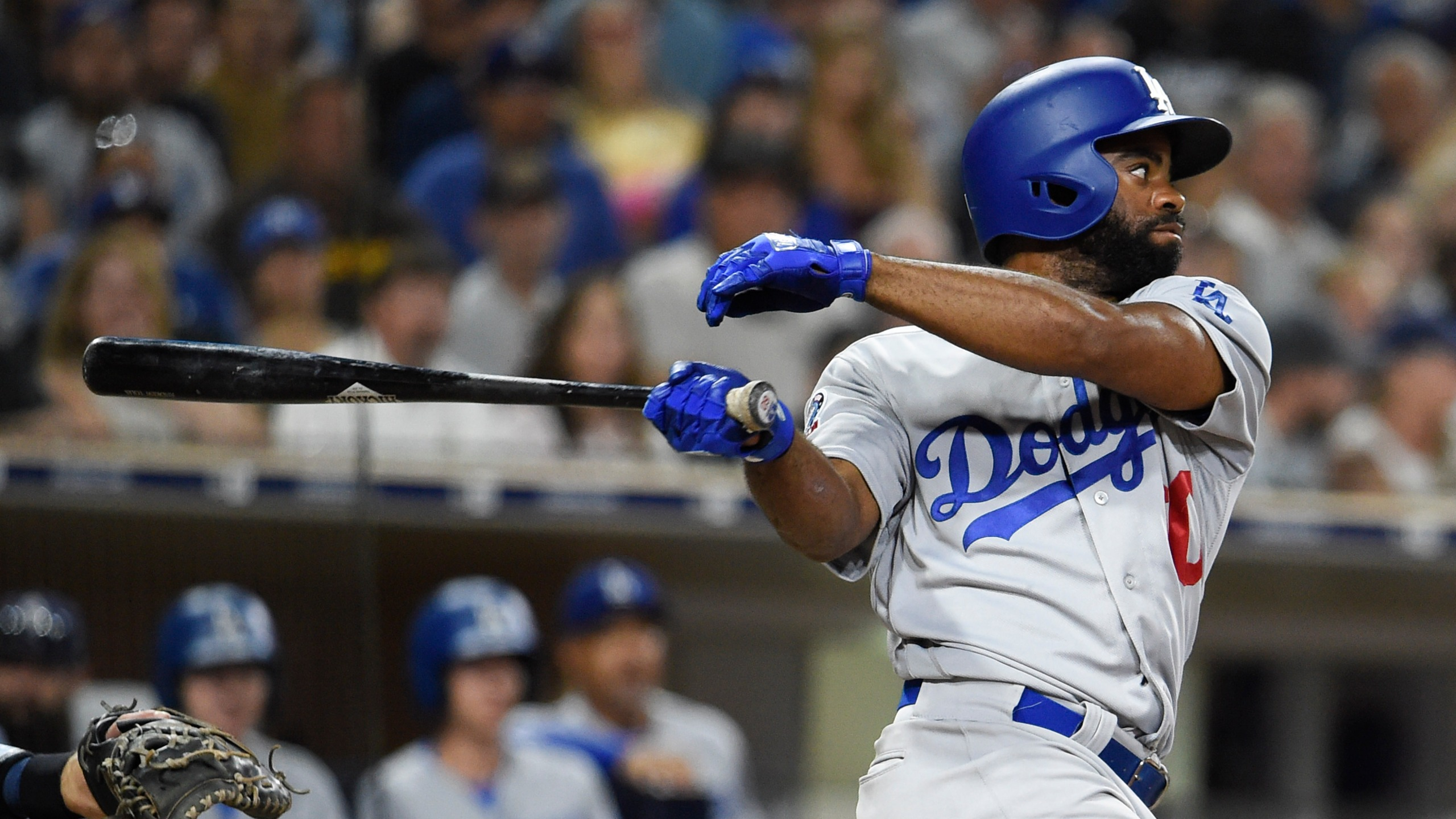 Andrew Toles of the Los Angeles Dodgers hits an RBI single during the seventh inning of a baseball game against the San Diego Padres at Petco Park on July 12, 2018 in San Diego. (Denis Poroy/Getty Images)