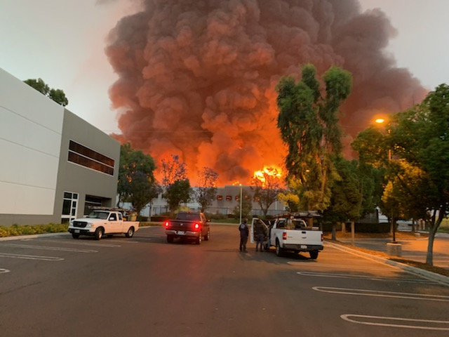 A fire at a commercial building in Redlands send smoke and flame billowing into the air on June 5, 2020. (Thomas Lin / KTLA)