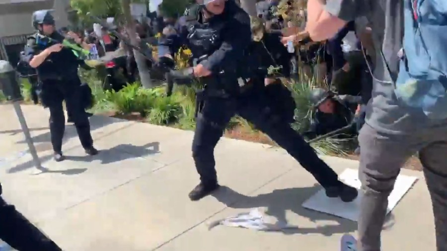 A Los Angeles Police Department officer strikes a protester with a baton in L.A.'s Fairfax District on May 30, 2020. (Matt McGorry)