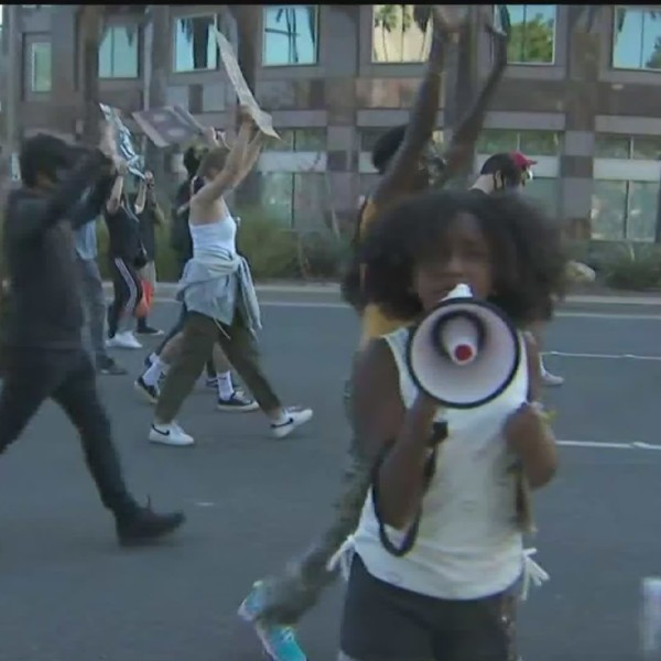 Demonstrators hold a march calling for racial justice in Anaheim on June 13, 2020. (KTLA)