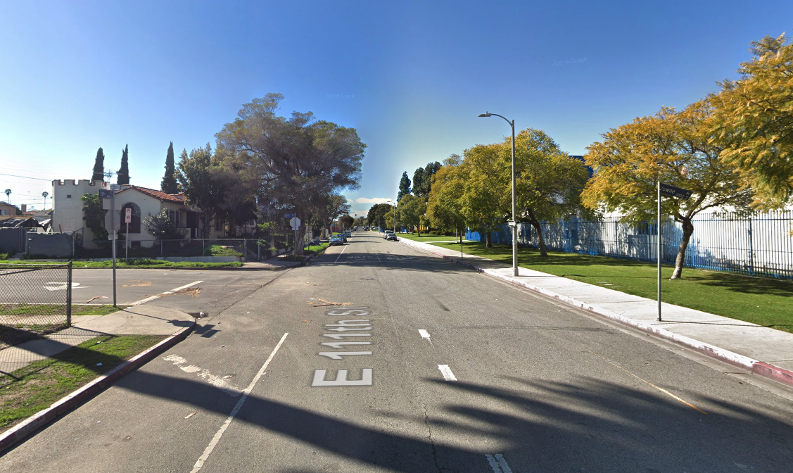 The intersection of 111th Street and Towne Avenue is shown in a Street View image from Google Maps.