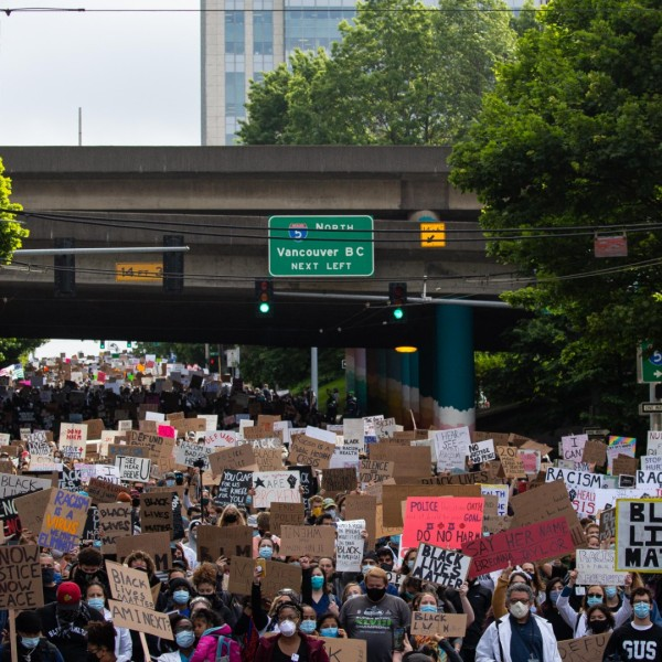 Healthcare workers and others march to Seattle City Hall during the Doctors For Justice event on June 6, 2020 in Seattle, Washington. This is the 12th day of protests since George Floyd died in Minneapolis police custody on May 25. (David Ryder/Getty Images)