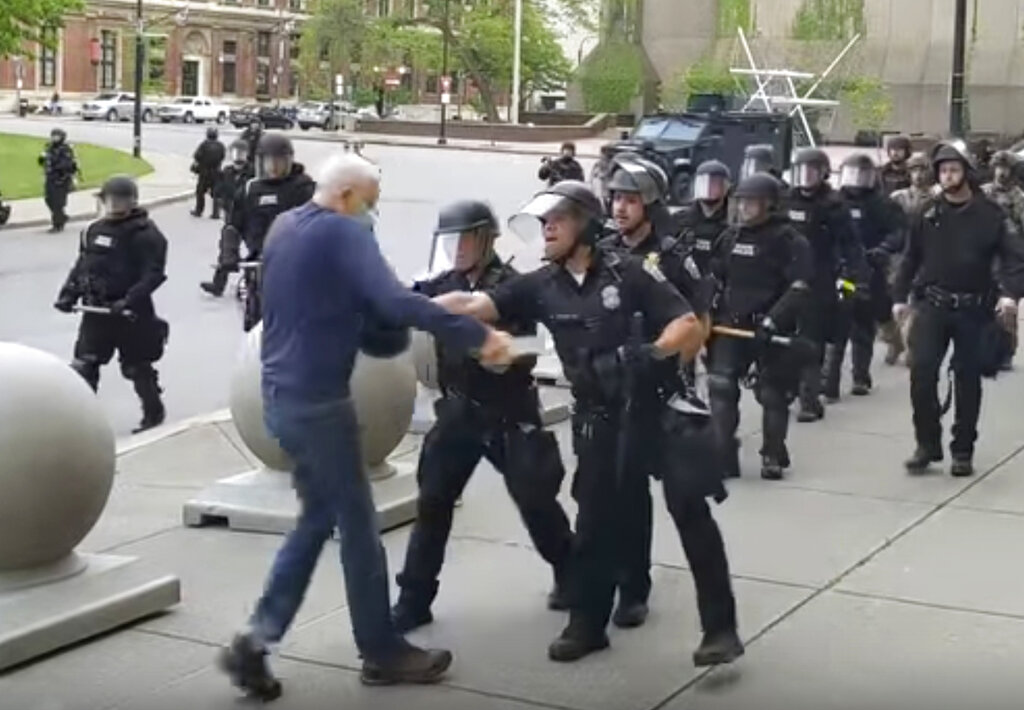 In this image from video provided by WBFO, a Buffalo police officer shoves a man who walked up to police June 4, 2020, in Buffalo, New York.