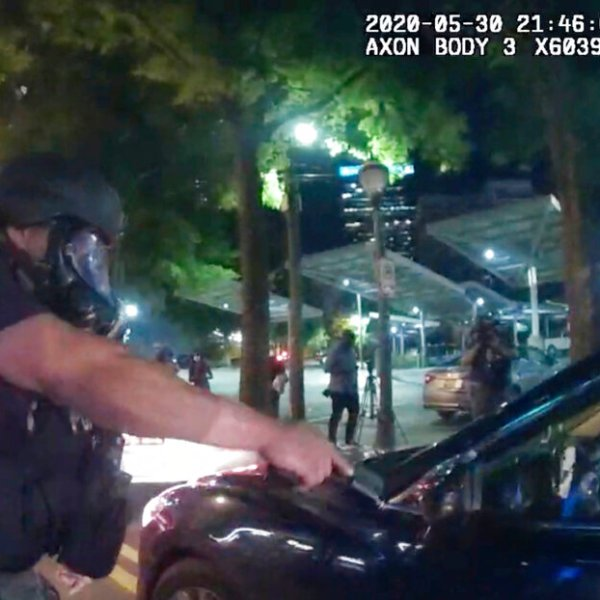 In body camera video released by the Atlanta Police Department, an officer points his handgun at Messiah Young while the college student is seated in his vehicle on May 30, 2020. (Atlanta Police Department via AP)