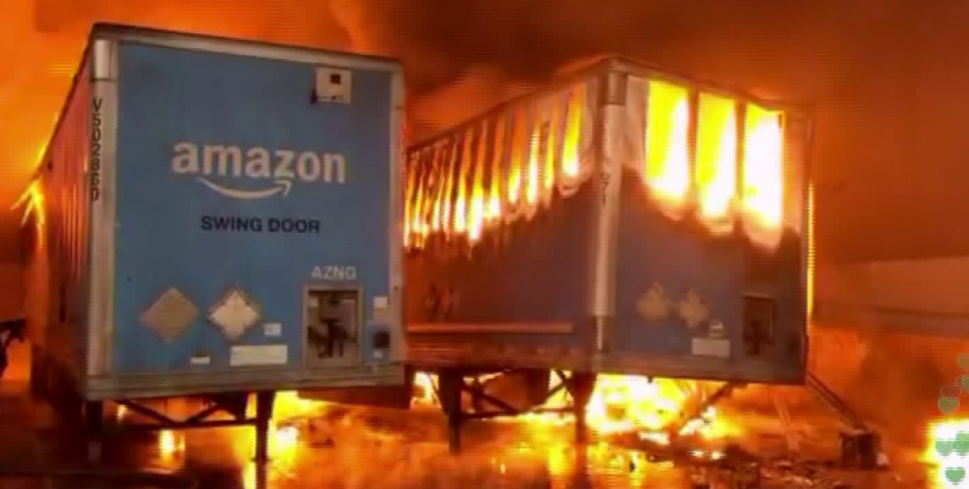 Amazon trailers go up in flames at a commercial building in Redlands on June 5, 2020. (KTLA)