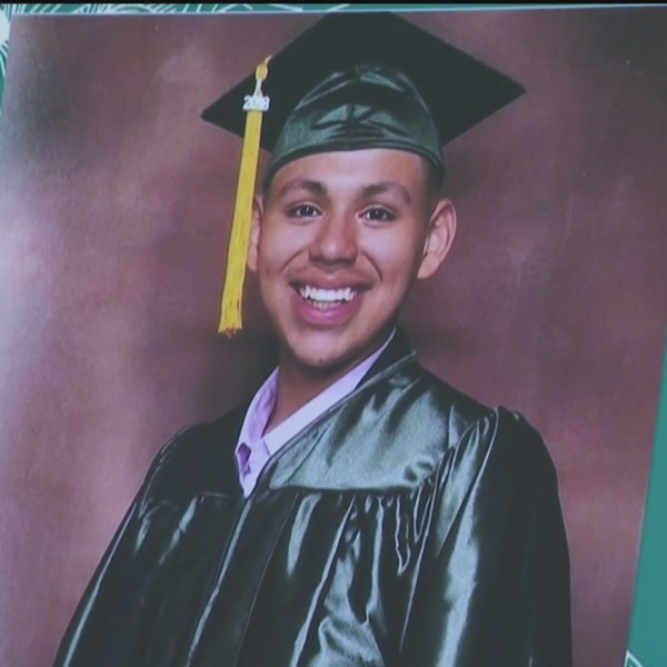 Andres Guardado wears a cap and gown in a photo displayed at a news conference held by his family in downtown Los Angeles on June 30, 2020. (KTLA)