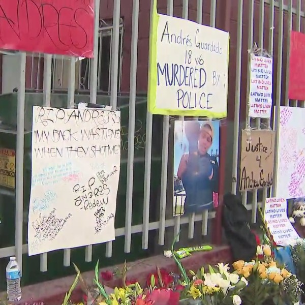 Flowers and signs demanding justice for the deadly deputy shooting of Andres Guardado are seen on June 20, 2020 in the Gardena area. (KTLA)