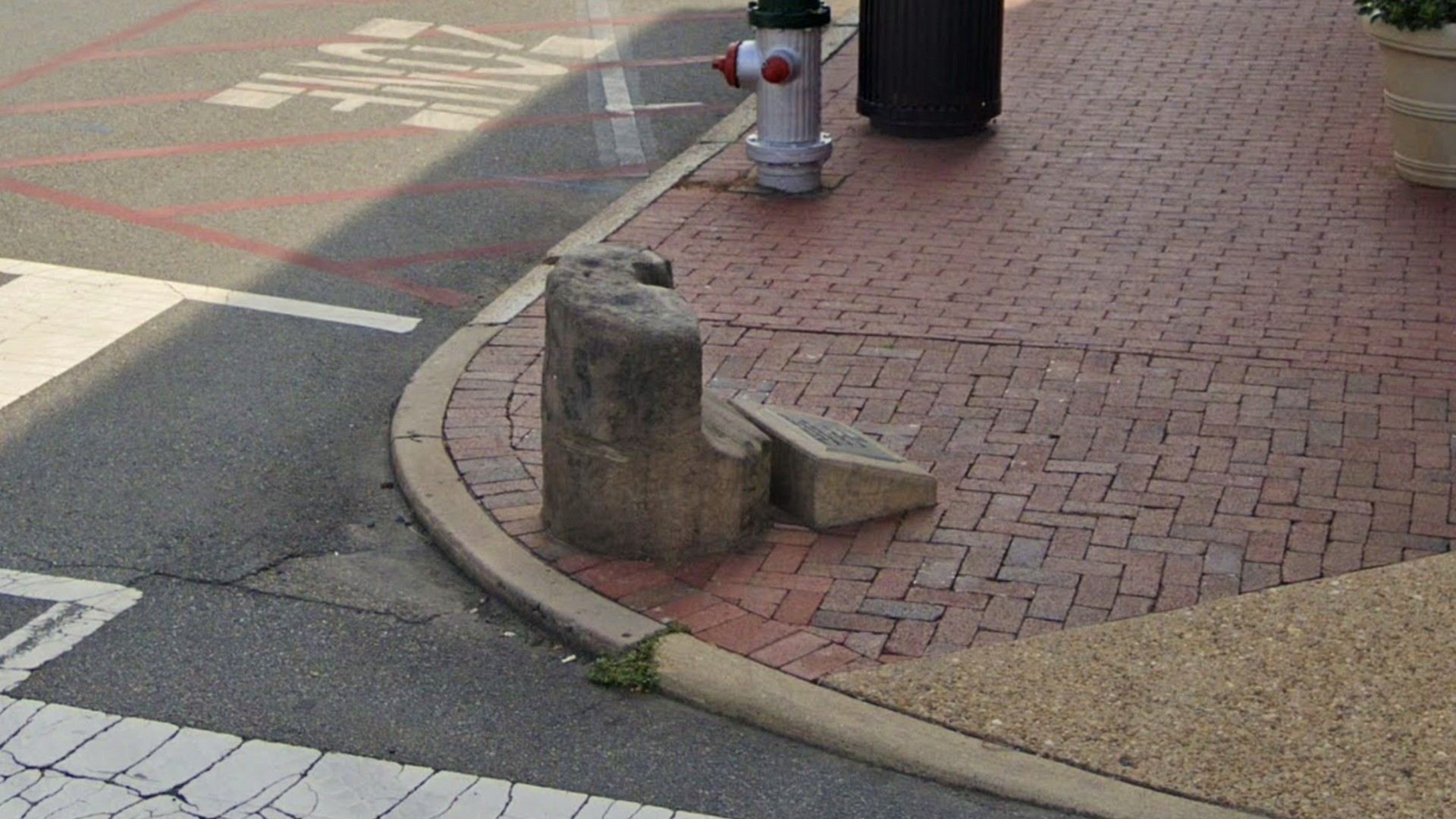 An 800-pound slave auction block is seen before its removal from Charles and William streets in downtown Fredericksburg, Virginia, in an image taken from Google Maps.