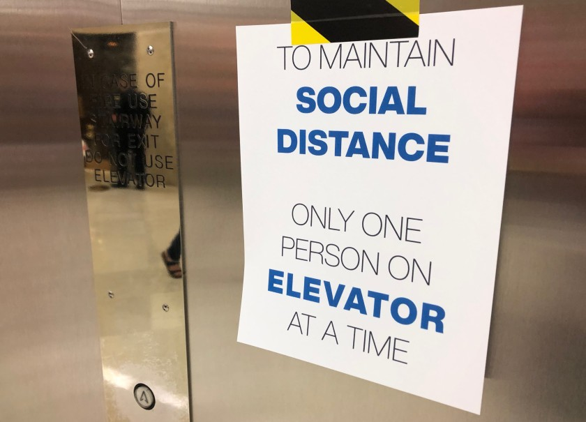 Elevators in the state Capitol have been limited to one person per ride and strict limits established on in-person seating for public hearings. (John Myers / Los Angeles Times)