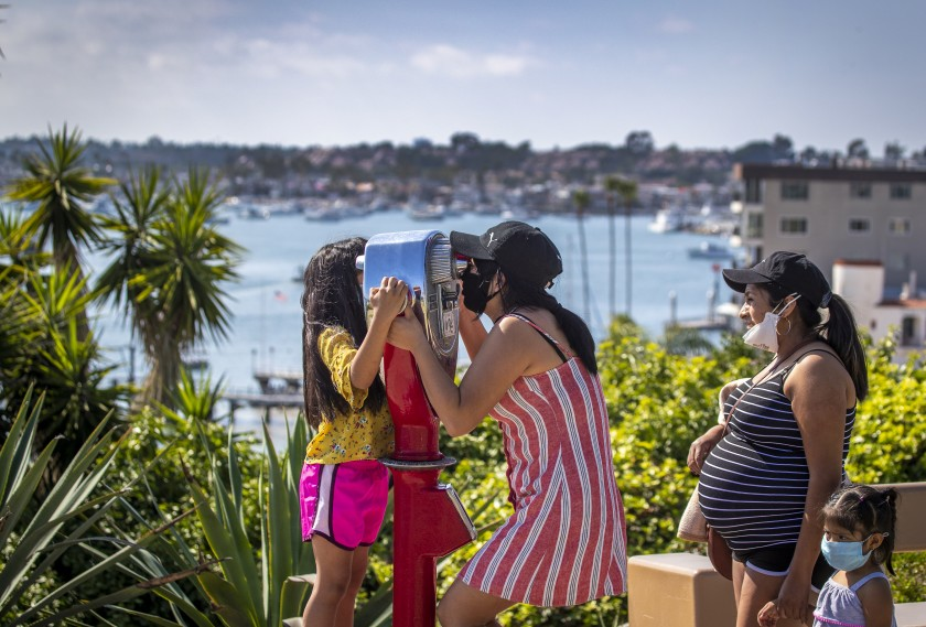 A family takes in the view of Newport Harbor at Lookout Point on Monday.(Allen J. Schaben / Los Angeles Times)