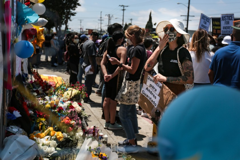 At the rally for Andres Guardado, mourners pay their respects at a makeshift memorial in his honor.(Jason Armond / Los Angeles Times)