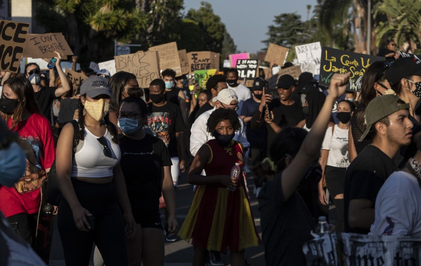 Protesters walk through a residential neighborhood in Hollywood on June 3, 2020, after encountering an LAPD skirmish line.(Brian van der Brug / Los Angeles Times)