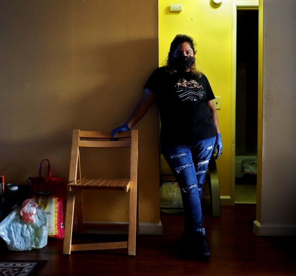 While Claudia Mendez, 42, was finding little work as a house cleaner because of coronavirus restrictions, and then she got COVID-19 herself. Her landlord locked her out, removed her belongings and even took out the toilet. A tenants rights group helped get her back into the apartment for now. (Gary Coronado / Los Angeles Times)