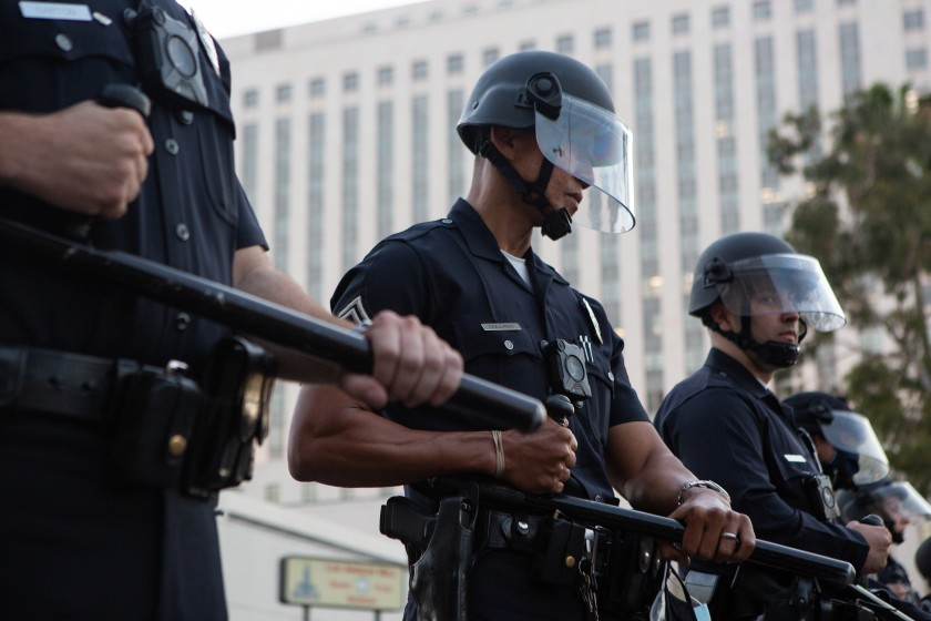 LAPD officers in riot gear form a police line during a May 27 Black Lives Matter protest in downtown L.A.(Gabriella Angotti-Jones / Los Angeles Times)