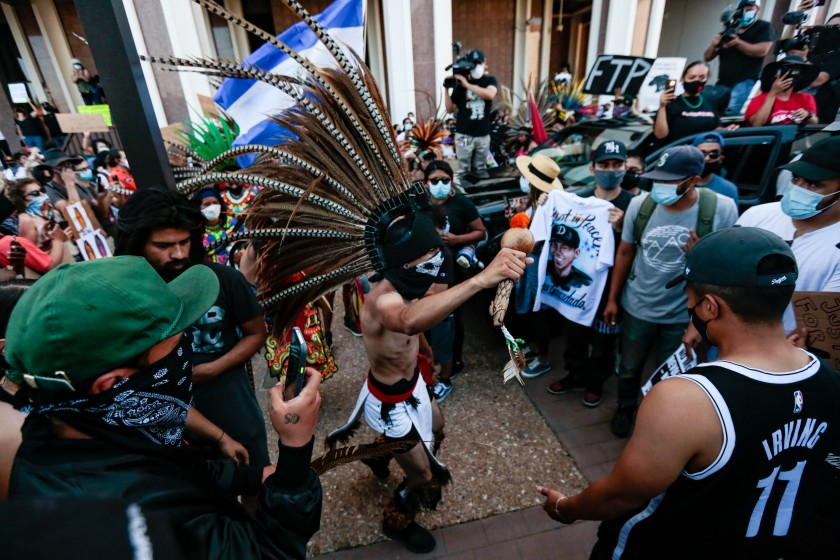 Aztec dancers join others outside the Compton sheriff's station to protest the fatal shooting of Andres Guardado, an 18-year-old security guard.(Jason Armond / Los Angeles Times)