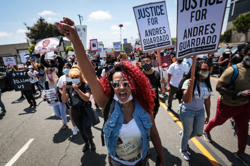 Protesters at a rally for Andres Guardado, a security guard was fatally shot by a Los Angeles County sheriff's deputy.(Jason Armond / Los Angeles Times)