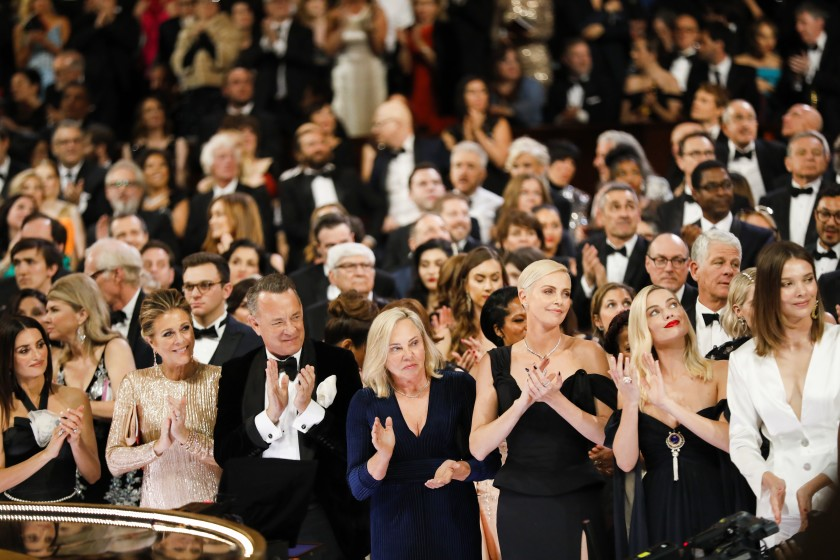"""The audience including Rita Wilson, Tom Hanks and Charlize Theron reacts as Renée Zellweger wins the lead actress Oscar for """"Judy"""" at the 92nd Academy Awards in February. (Al Seib/Los Angeles Times)"""