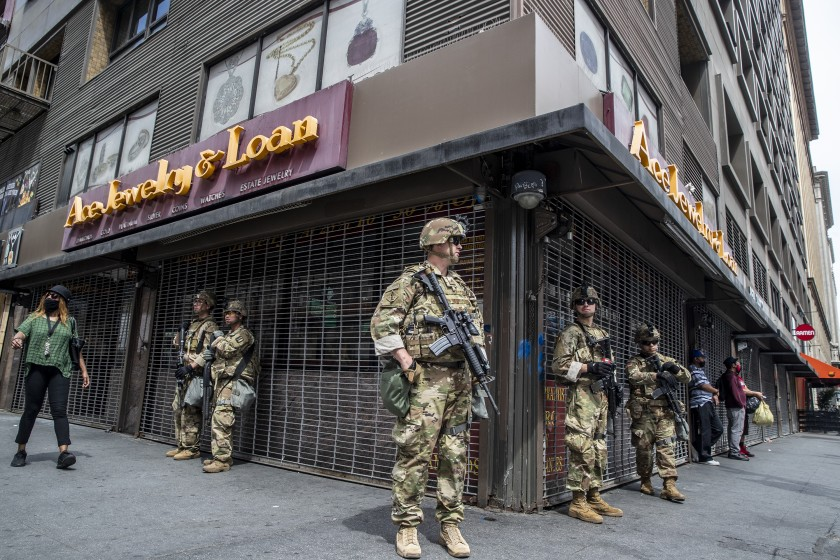 National Guard troops stand guard on June 2, 2020 at the corner of Seventh Street and Broadway as George Floyd protests continue in downtown L.A.. (Robert Gauthier/Los Angeles Times)