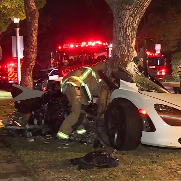Firefighters work to rescue the driver and passenger in a sports car that crashed outside the mayor's residence in Windsor Square on June 13, 2020. (RMG News)