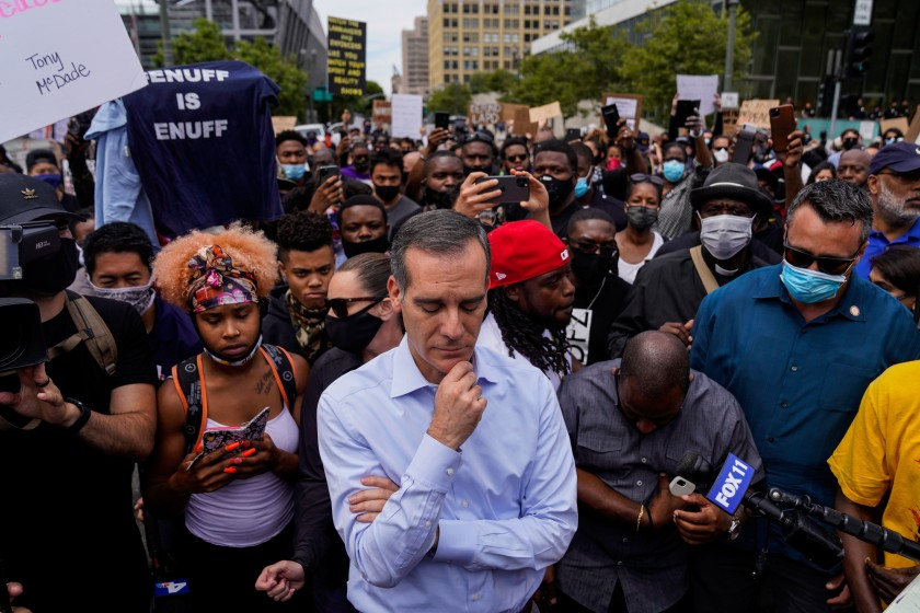Mayor Eric Garcetti meets with protesters and clergy members during a peaceful street protest in downtown Los Angeles on Tuesday. (Kent Nishimura / Los Angeles Times)