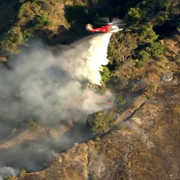 A water drop is made on a brush fire in the Hollywood Hills on June 9, 2020. (KTLA)