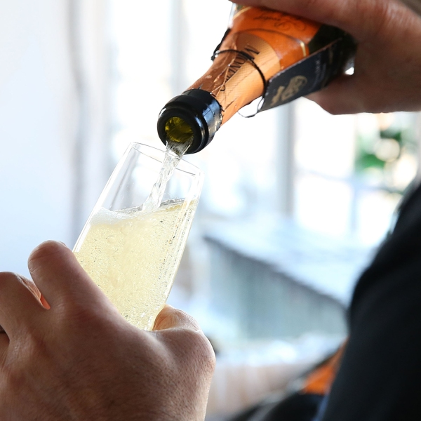 A bartender pours Mionetto Prosecco at Founder's Welcome Breakfast during Food Network New York City Wine & Food Festival Presented By FOOD & WINE at Hudson 24th Floor Apartment Terrace on October 17, 2014 in New York City. (Mireya Acierto/Getty Images for NYCWFF)
