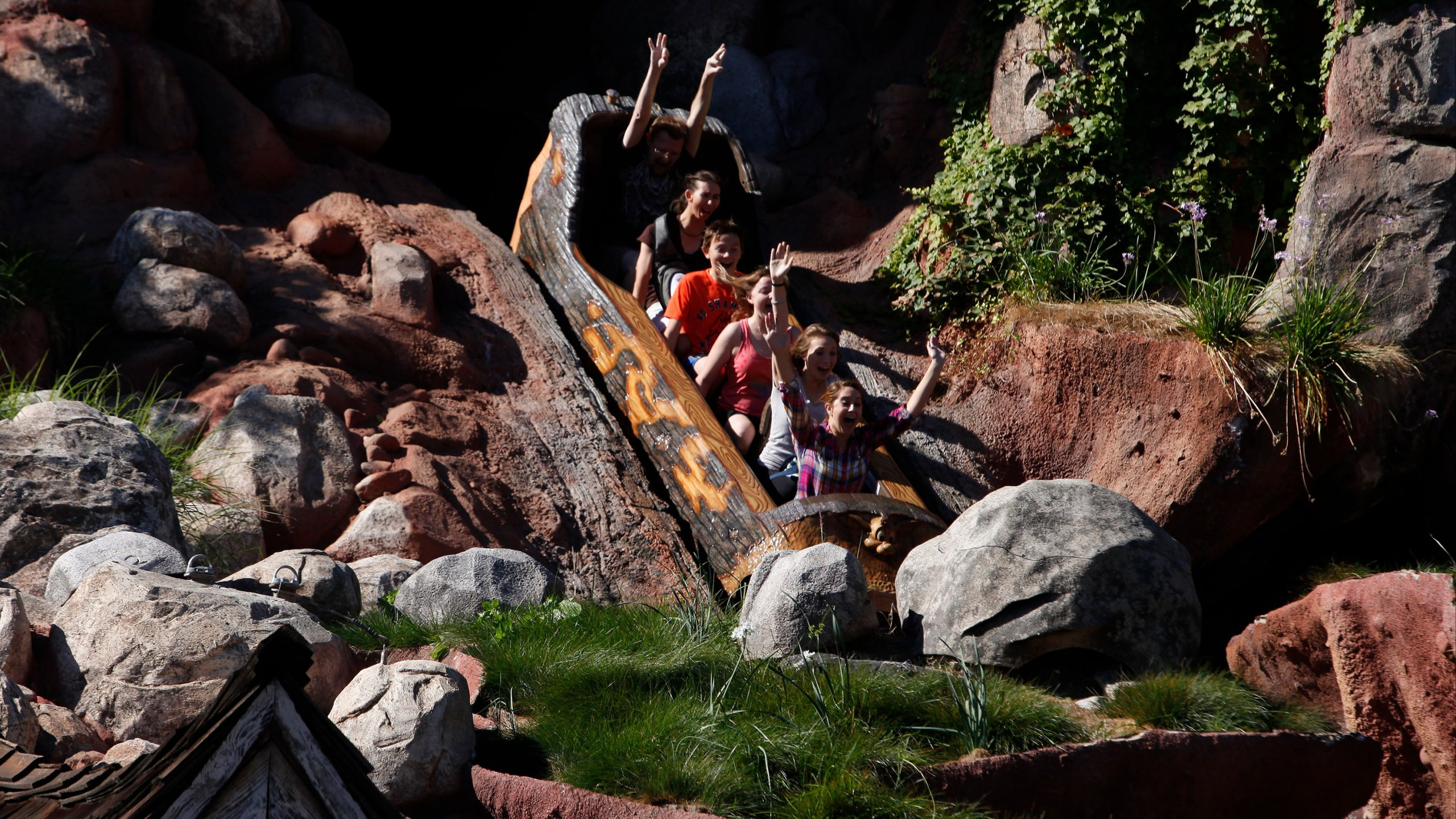 Guests ride Splash Mountain at Walt Disney Co.'s Disneyland Park, part of the Disneyland Resort, in Anaheim, on Nov. 6, 2013. (Patrick Fallon/Bloomberg via Getty Images)