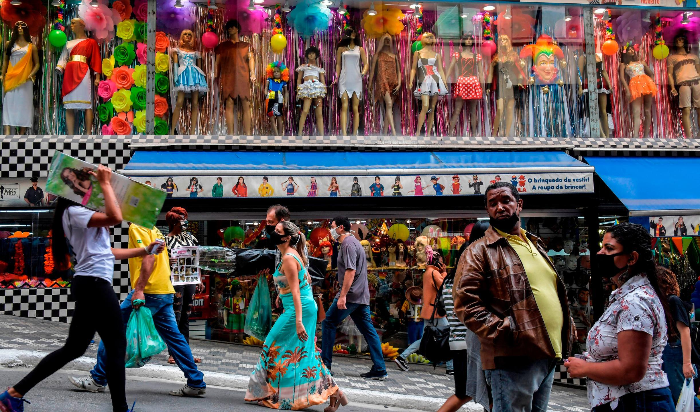 People walk along a street in downtown Sao Paulo, Brazil on June 10, 2020. (NELSON ALMEIDA/AFP/Getty Images)