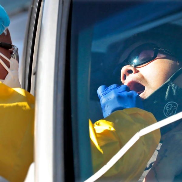 People get tested for COVID-19 at a drive through testing site hosted by the Puente Movement migrant justice organization Saturday, June 20, 2020, in Phoenix. (Matt York/AP via CNN Wire)