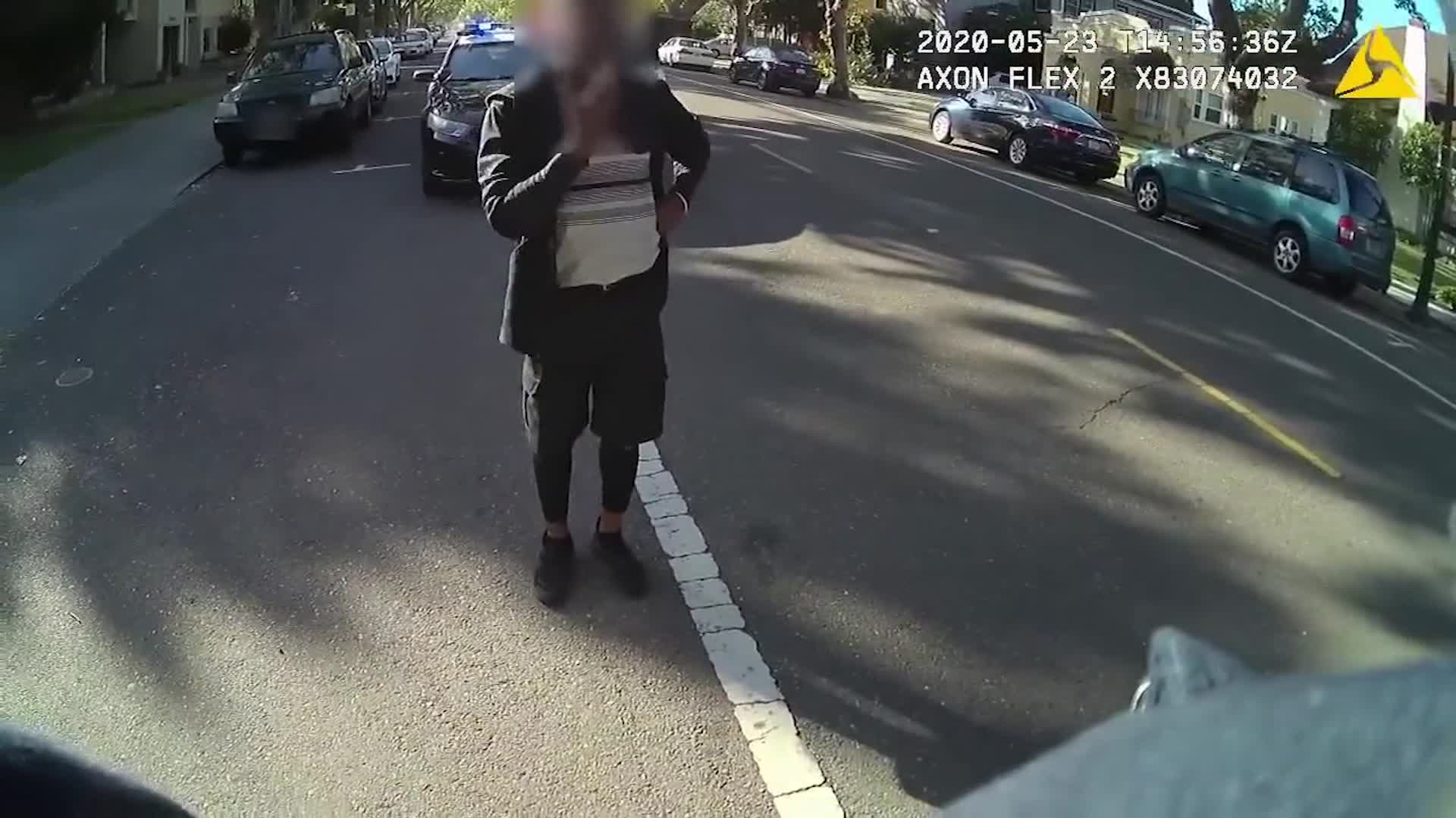 A black man dancing in the street of a Northern California city was pinned to the ground and placed under arrest by police after officers were called to the scene, newly-released officer body cam video shows. His face was blurred by police. (City of Alameda)