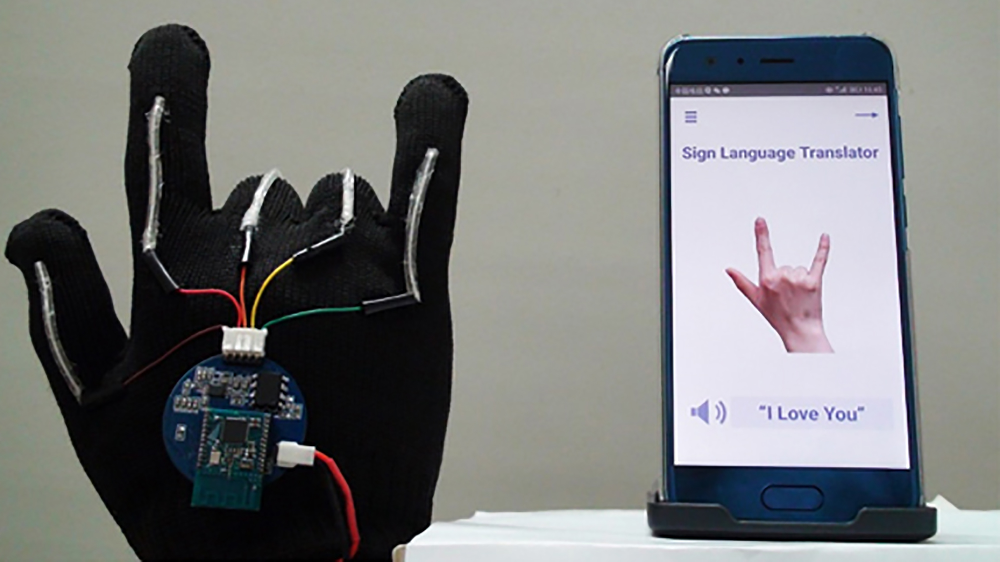 A glove that translates sign language into speech in real time has been developed by scientists -- potentially allowing deaf people to communicate directly with anyone, without the need for a translator. UCLA)