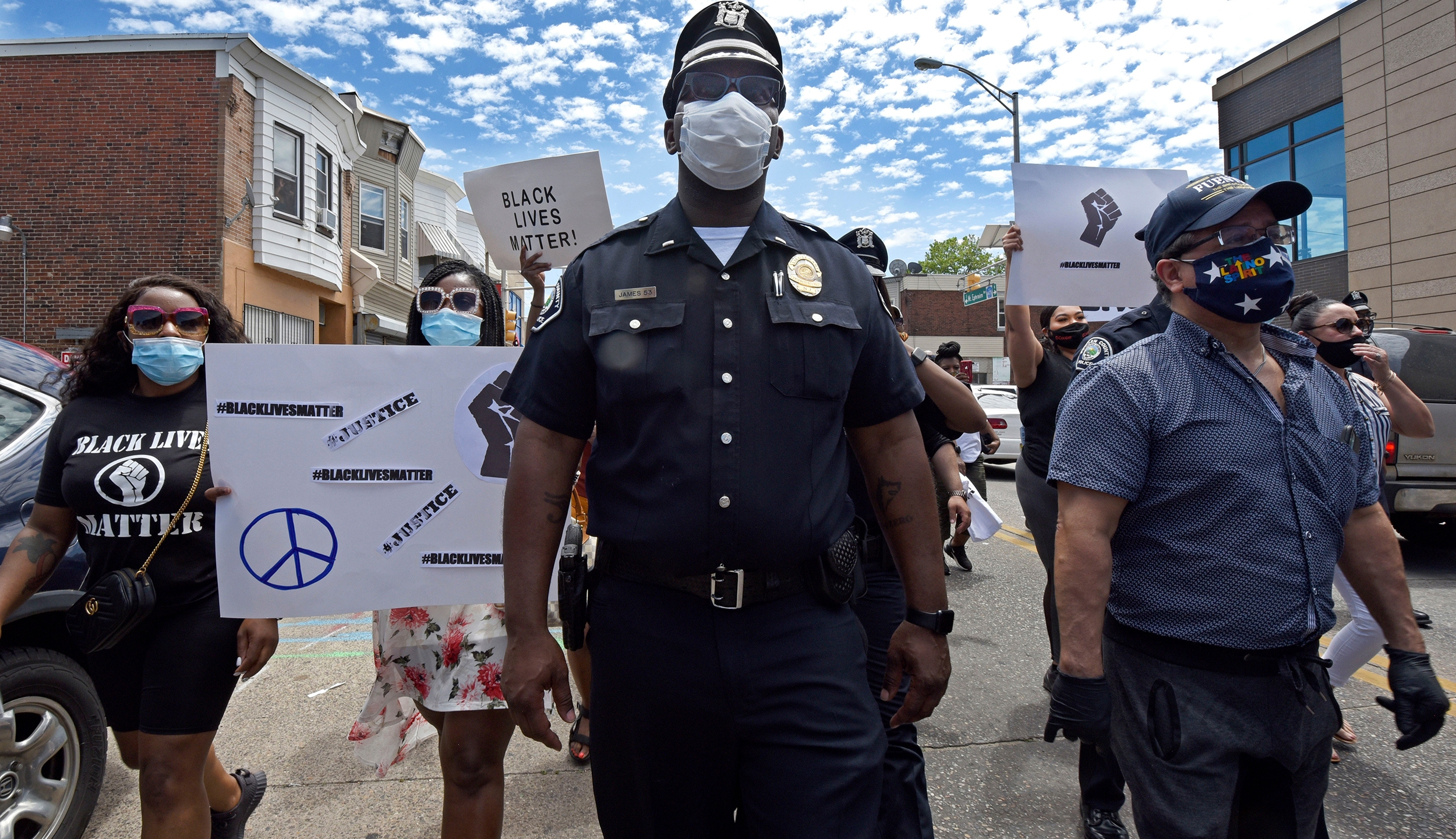 In this May 30, 2020, photo, Lt. Zack James of the Camden County Metro Police Department marches along with demonstrators in Camden, N.J., to protest the death of George Floyd in Minneapolis. (April Saul via CNN)