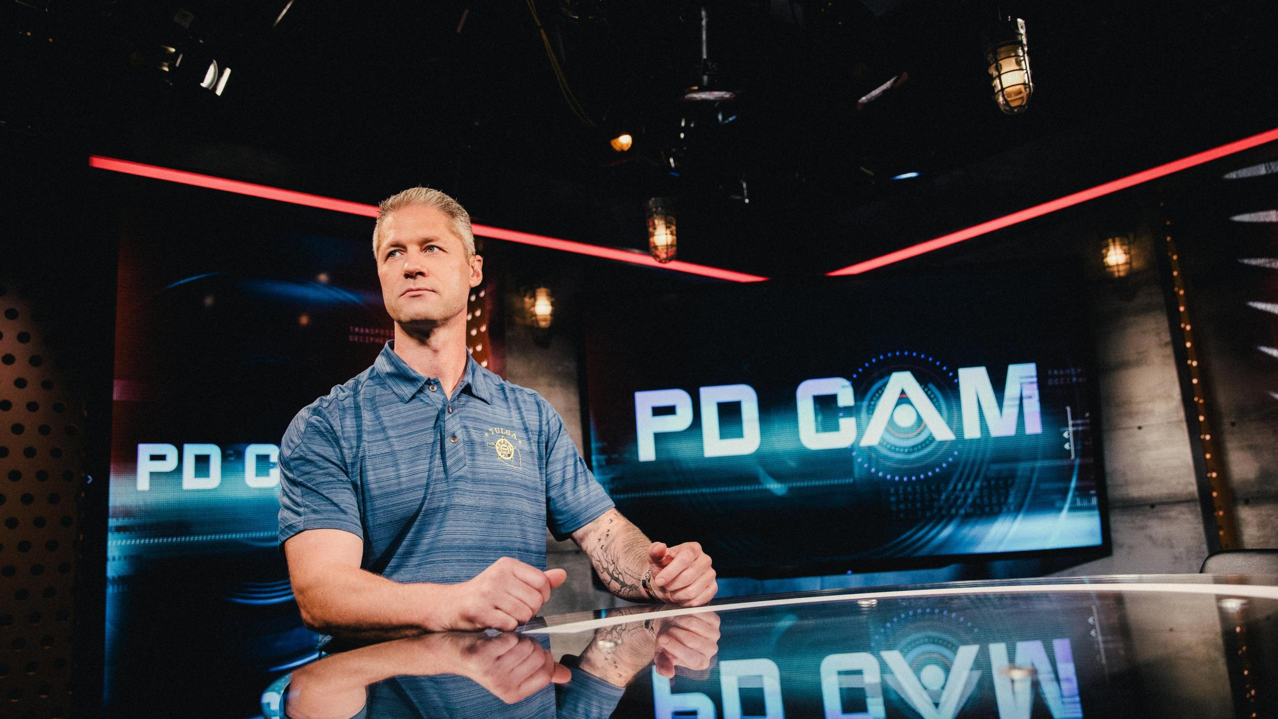 """Sgt. Sean """"Sticks"""" Larkin of the Tulsa Police Department hosts 'Live PD Presents: PD Cam.' A&E has canceled the police reality series as the debate over the role of police in the US intensifies. (Patrick T. Fallon/A&E)"""