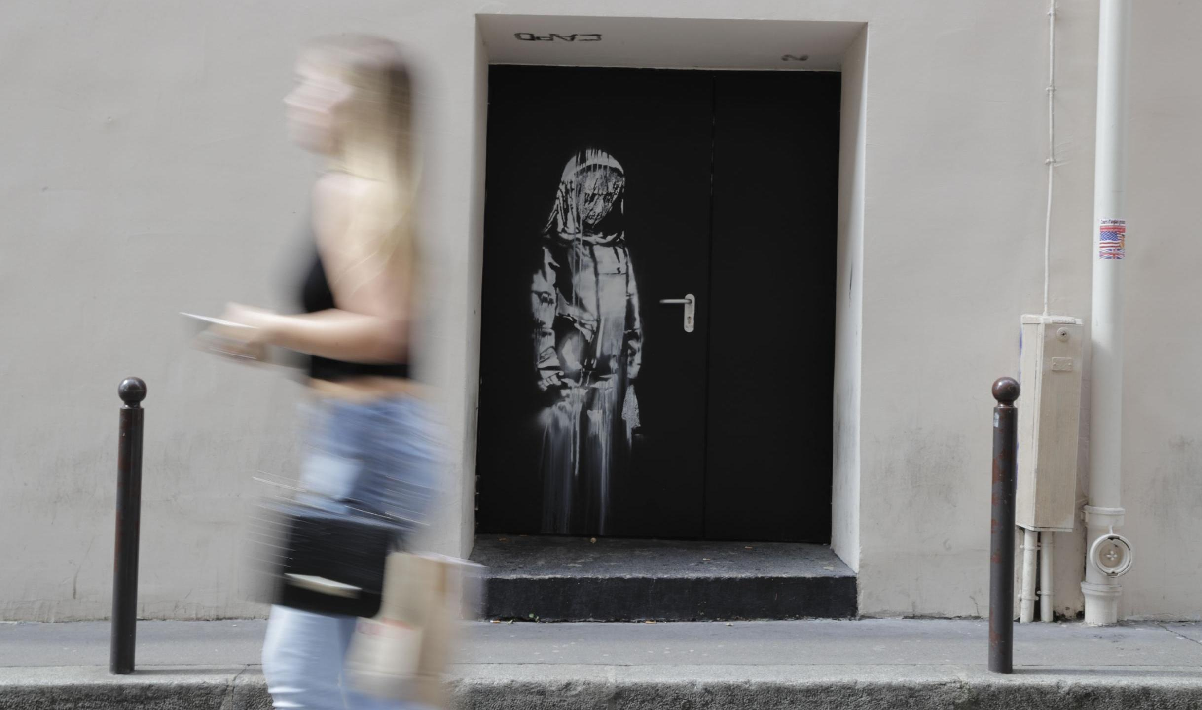 The Banksy artwork, seen here in June 2018, was on a side door of the Bataclan concert hall. (THOMAS SAMSON/AFP/AFP/Getty Images)