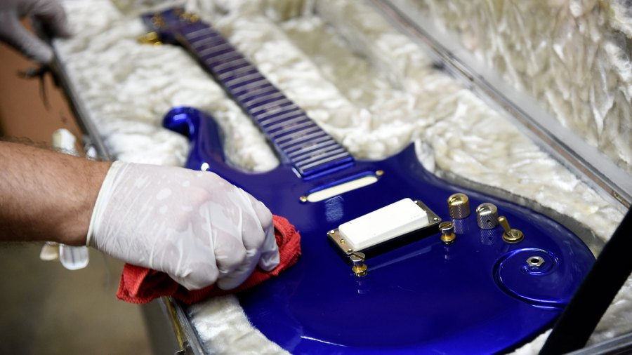 """A blue """"cloud"""" guitar custom-made in the 1980s for the late musician Prince is polished at Julien's Auctions warehouse on May 6, 2020, in Culver City. (AP Photo/Chris Pizzello via CNN)"""