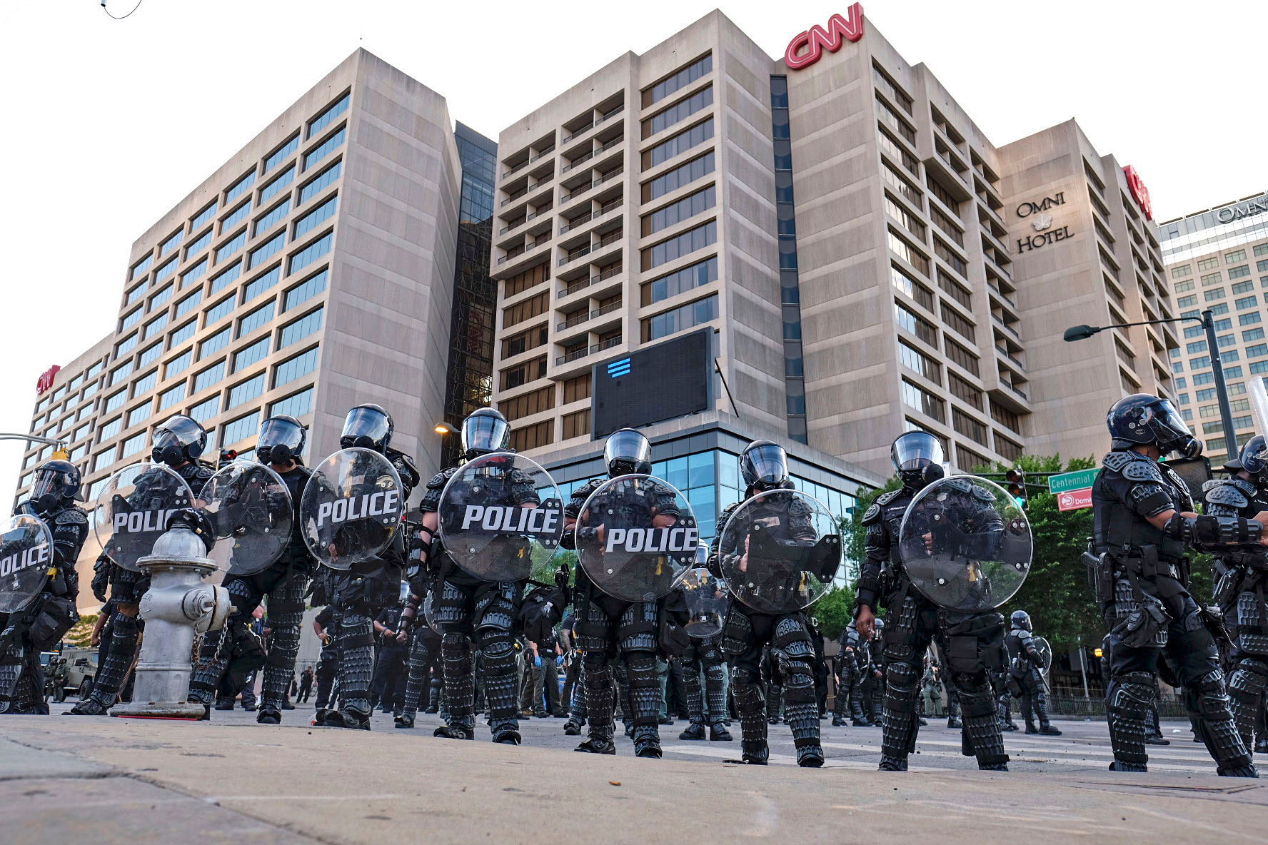 Police stand guard around the CNN Center and Centennial Olympic park as protests continue over the death of George Floyd, Saturday, May 30, 2020, in Atlanta. (Ben Gray/Atlanta Journal-Constitution/AP)