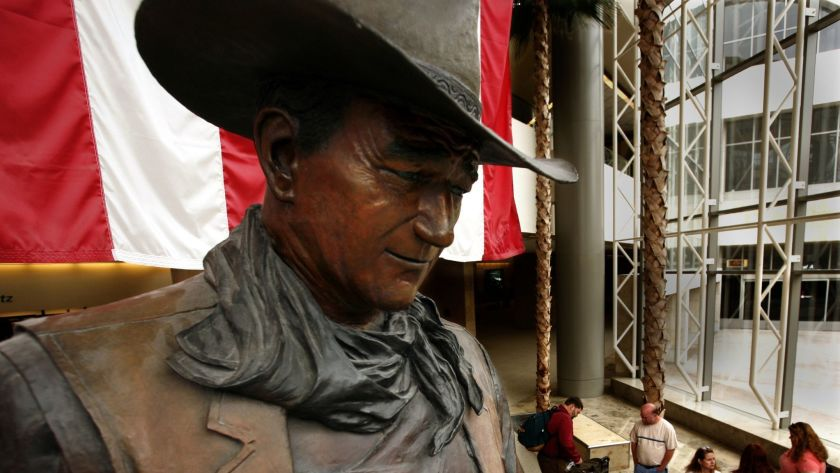 A statue of John Wayne at the John Wayne Airport is seen in this undated photo. (Mark Boster / Los Angeles Times)
