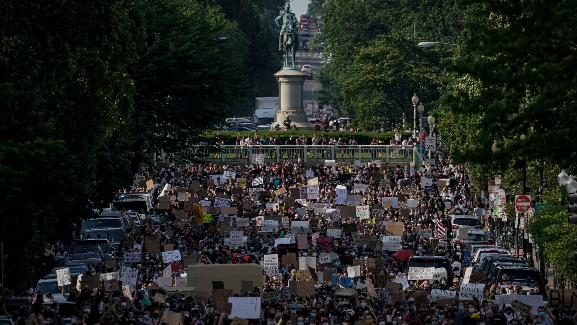 Hundreds of demonstrators march toward Lafayette Park and the White House to protest against police brutality and the death of George Floyd, on June 2, 2020 in Washington, DC. (Drew Angerer/Getty Images)