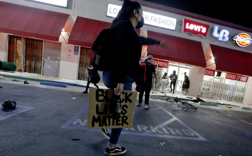 A strip mall at Seventh Street and Long Beach Boulevard in Long Beach is ransacked on May 31, 2020. (Luis Sinco / Los Angeles Times)