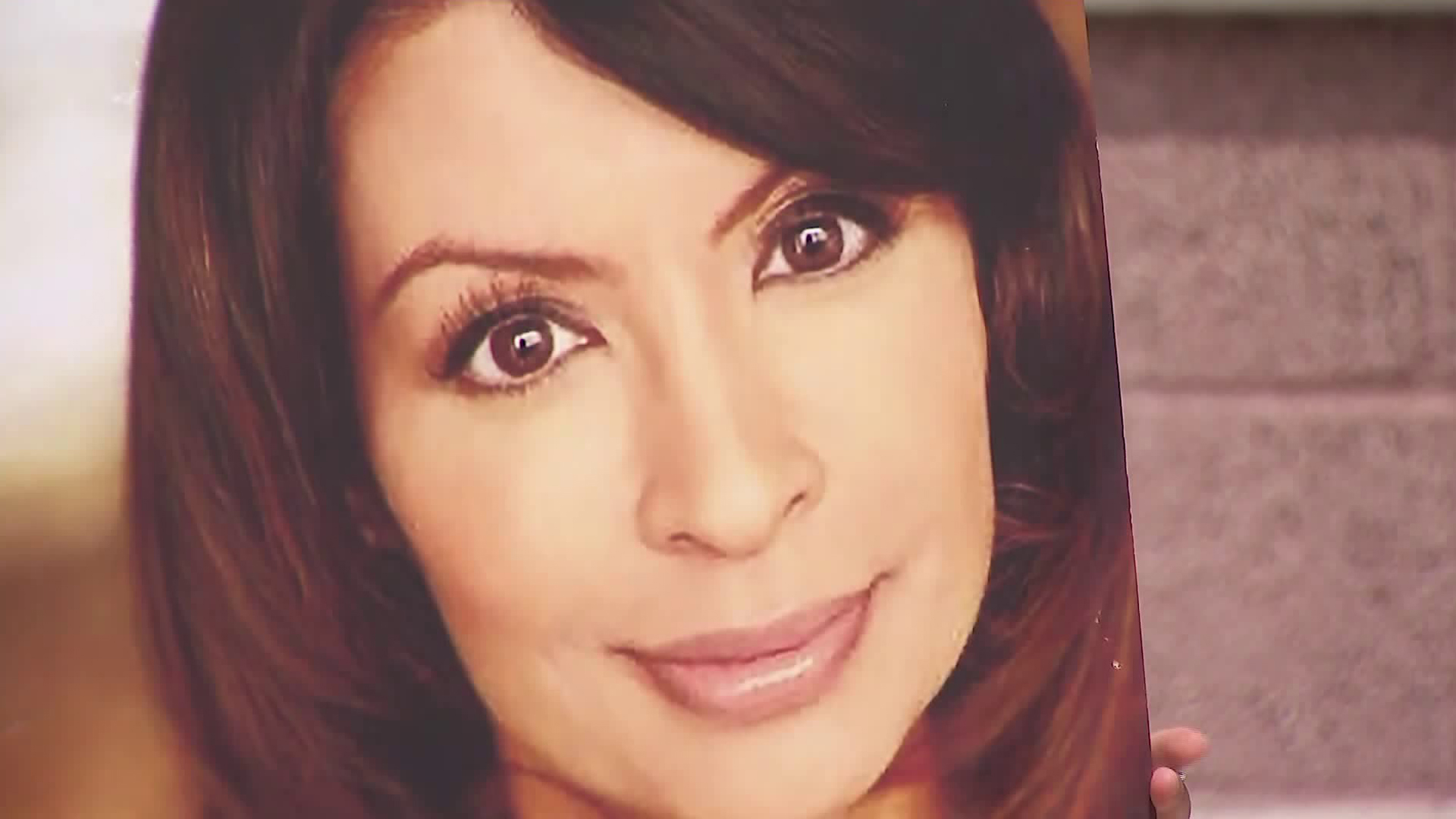 An undated photo of Vanessa Marquez is held by a demonstrator during a news conference announcing a wrongful death lawsuit on June 24, 2020. (KTLA)