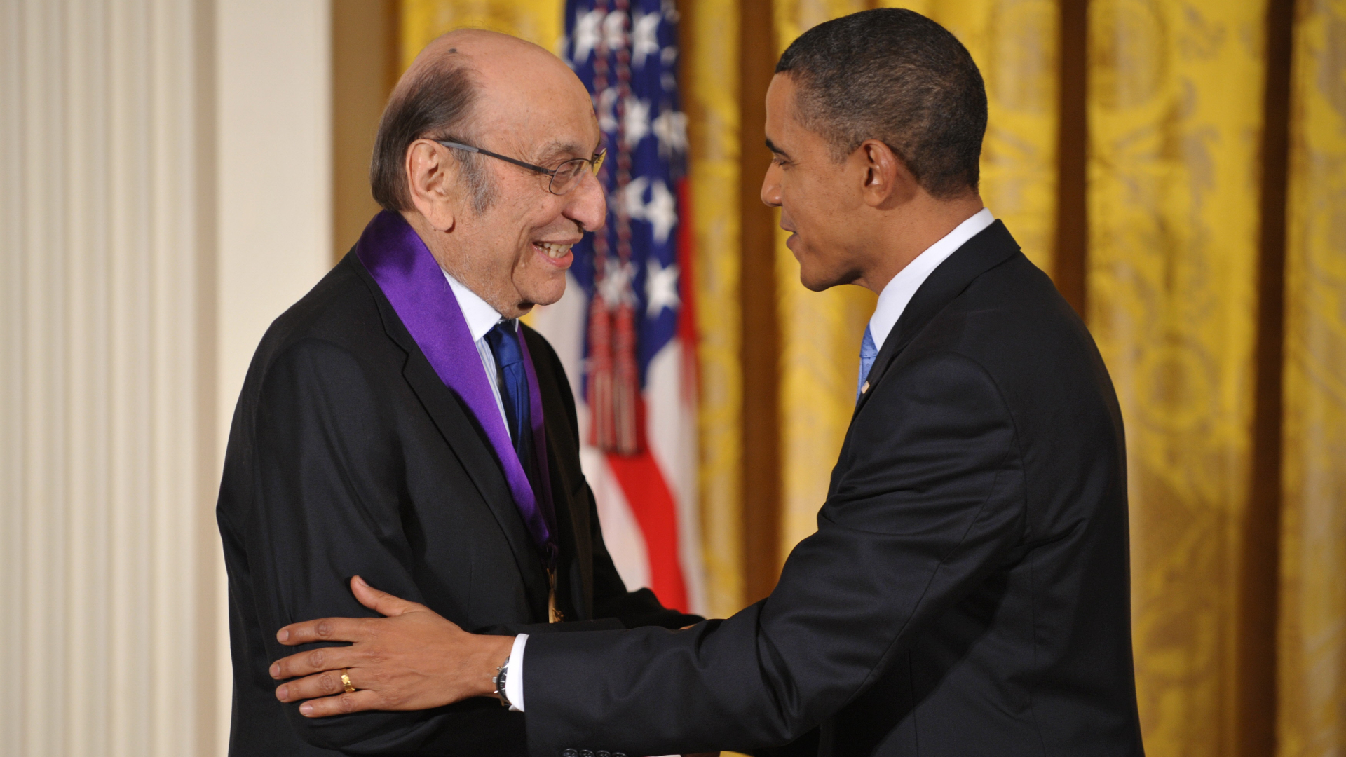President Barack Obama shakes hands with graphic designer Milton Glaser after presenting him with the 2009 National Medal of Arts during a ceremony at the White House on Feb. 25, 2010. (Mandel Ngan / AFP / Getty Images)