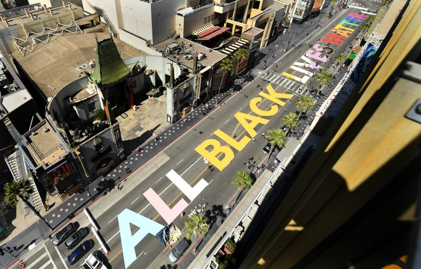 """""""All Black Lives Matter"""" is painted on Hollywood Boulevard in front of TCL Chinese Theatre on June 13, 2020. (Wally Skalij / Los Angeles Times)"""