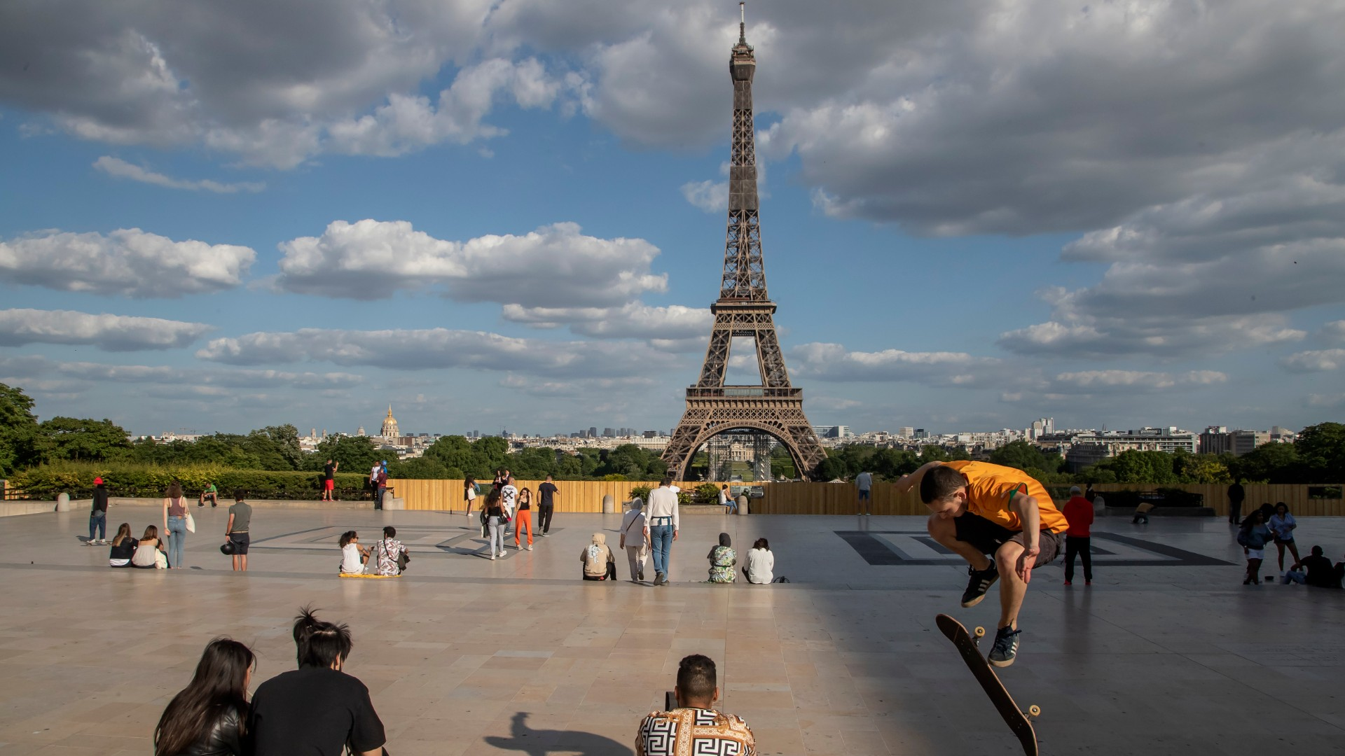 In this Monday, May 25, 2020 file photo, people stroll at Trocadero square near the Eiffel Tower in Paris. (AP Photo/Michel Euler, File)