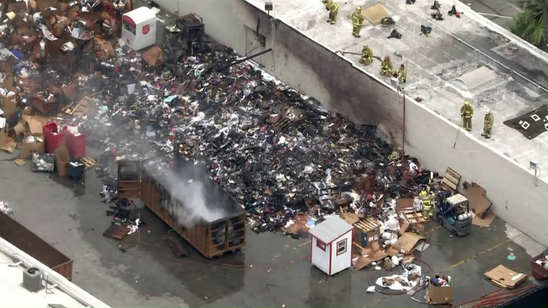 Piled up donations burned outside a Salvation Army store in Pasadena on June 17, 2020. (KTLA)